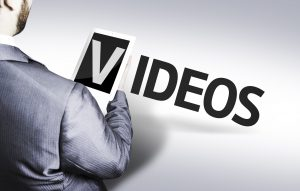 Business man with the text Video in a concept image